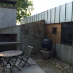 Concrete Fireplace Outside Home in Goshen, Indiana